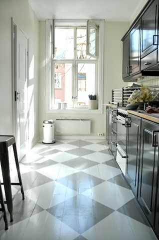 Fun painted wood floors, love the diagonal pattern to make a small galley kitchen seem bigger.