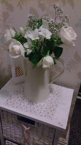 Cute jug flower arrangement.