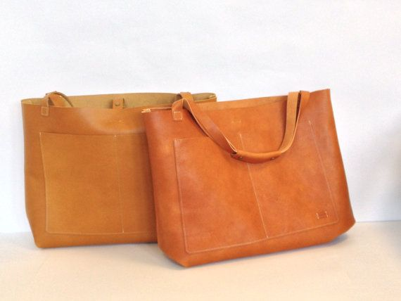"""Nomad Leatherwork (Etsy) $385 19"""" x 15"""" x 5.5"""" Pinched corner construction, larger outer pockets, strap with snap buttons as inside closure, handles have an added leather sleeve for comfort"""