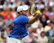 Andy Roddick of the United States returns a shot to Novak Djokovic of Serbia during the second round of Men