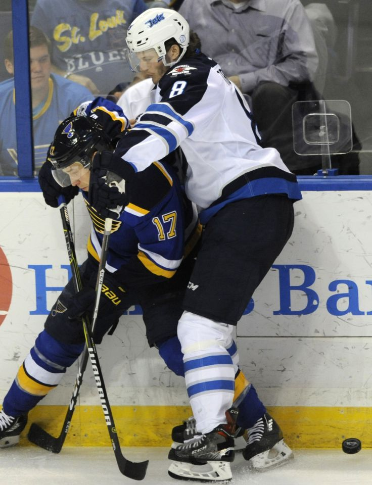 St. Louis Blues' Jaden Schwartz (17) battles for the puck with Winnipeg Jets' Jacob Trouba (8) during the second period of an NHL hockey game, Tuesday, April 4, 2017, in St. Louis. (AP Photo/Bill Boyce)