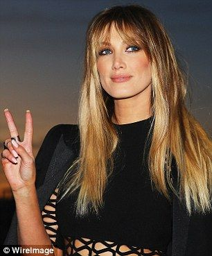 Bold beauty look: Delta wore her lengthy locks loose in a sleek and straight style and wore lashings of eyeliner