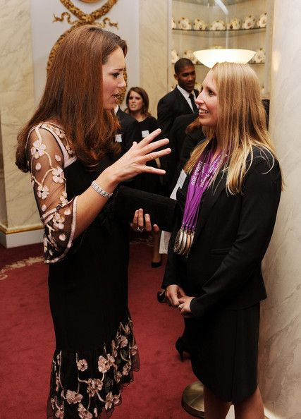 Catherine, Duchess of Cambridge talks to paralympic swimmer Stephanie Millward during a reception held for Team GB Olympic and Paralympic London 2012 medalists at Buckingham Palace on October 23, 2012 in London, England.