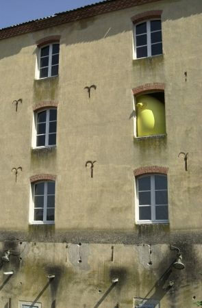 Hans Hemmert , Without title (yellow sculpture fitting to old mill), 1998