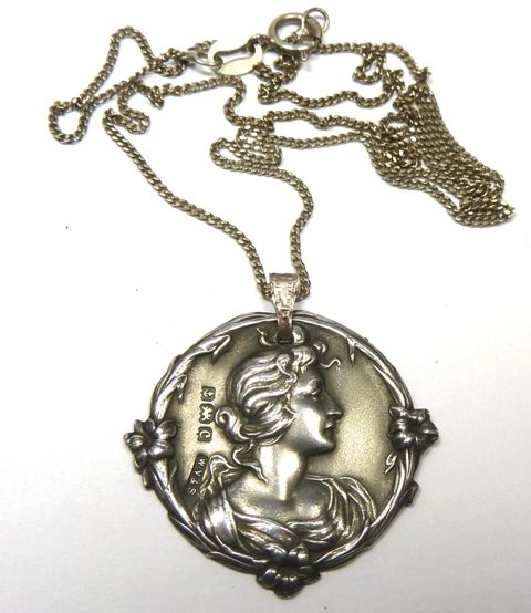 Art Nouveau small silver pendant of a lady - William Vale & Sons Birmingham 1902-3 hallmark.  Photographed by Gillian Horsup