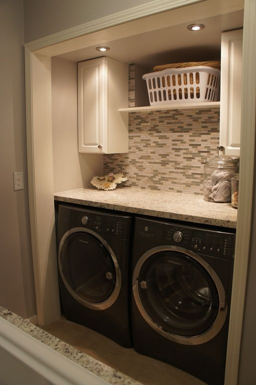 Contemporary Laundry Room With Undermount Sink, Limestone Tile Floors,  Giallo Ornamental Granite, Built In Bookshelf