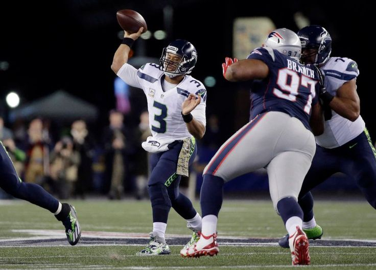 Seahawks vs. Patriots:  31-24, Seahawks  -  November 10, 2016  -    Seattle Seahawks quarterback Russell Wilson passes under pressure by New England Patriots defensive lineman Alan Branch during the first half of an NFL football game, Sunday, Nov. 13, 2016, in Foxborough, Mass.