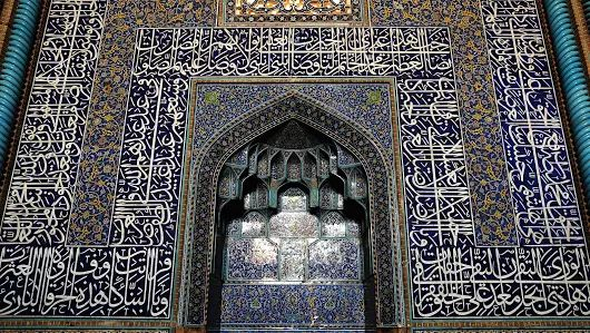 A Grand Prayer: The Mihrab of Shaikh Lotfollah Mosque, in which the building was completed in 1619 AD during the reign of Shah Abbas I who took the empire to its peak period.   Like the other worship buildings which were built during Safavid period, the mosque is also heavily dominated by Thuluth Qur'anic calligraphy, cobalt blue tile with illuminated floral foliages and a complex muqarnas construction.  Esfahan, April 2017
