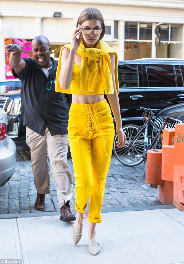 Work it: The sister of Bella Hadid put her svelte pins on display in the lace front capris that were rolled at the ankles