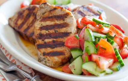 Grilled Greek-Style Pork Chops with Tomato-Cucumber Salad // Fire up the grill!