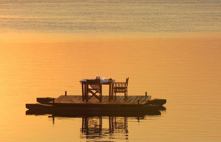 Zambia luxury safari holidays | Tongabezi Lodge | Zambia Lodge Victoria Falls-They serve a romantic dinner to you by canoe
