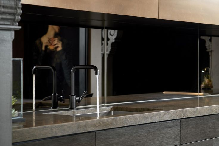 Purist Kitchen Faucet     Strive Kitchen Sink     A clean matte black faucet is the right choice for a minimalist look in the task area, allowing the utilitarian elements of the kitchen to simply blend into the background.