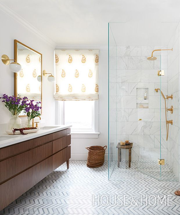 A paisley-printed roman blind, walnut vanity and brass accents give this white bathroom a warm, welcoming feel. | Photographer: Alex Lukey | Designer: Sam Sacks