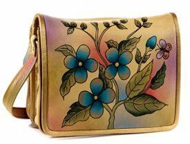 Magnifique Blue/Gold Flowers Leather Hand Painted Handbag  Trendy, Cute and Luxurious Hand Painted Leather Purses      Hand painted leather purses are truly eye-catching, unique and cool.  In fact they are currently trending like crazy!  Obviously when you combine beautiful hand painted art, on fine quality leather the result is a timeless and charming creation just for you.