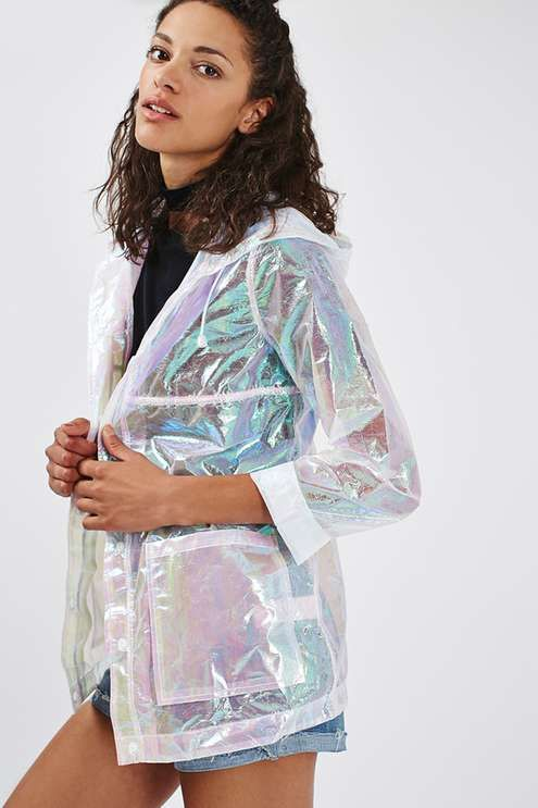 Stay cute whatever the weather throws at you with this hooded rain mac. Detailed with an all-over metallic-look holographic finish, it comes with a popper fastening to the front, patch pockets and a drawstring hood. #Topshop