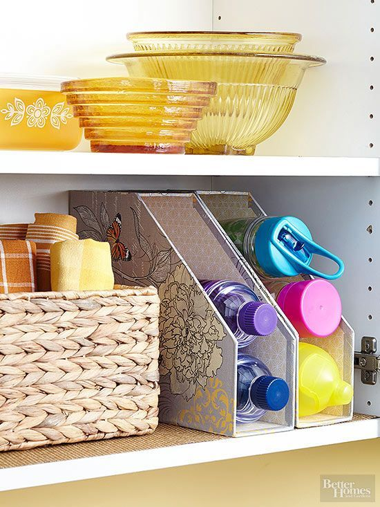 Keep water bottles within reach and in view by stacking them in magazine files. Rest the inexpensive organizers on their backs for quick grab-and-go access./