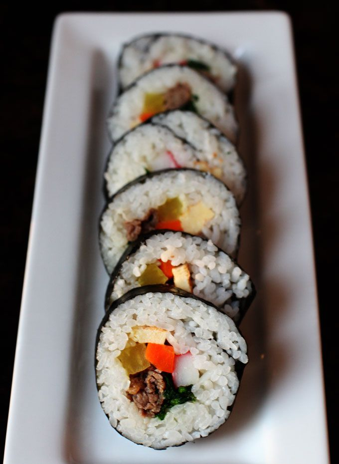 Korean Kimbap Rolls--Unlike Japanese sushi rolls, kimbap rice is typically seasoned with sesame oil and salt and is usually filled with egg, beef, carrots, spinach, pickled daikon and other ingredients.Korean Kimbap, Kimbap Rolls, Kimbap Recipe, Kitchens Exploration, How To Make Korean Food, Food Drinks 2, Nom Nom, Sushi Rolls, Receptions Food