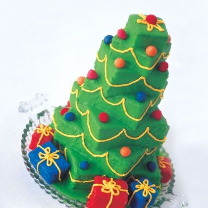 Towering Tree Cake. Bake cake in 9x13 pan, cut into squares & stack them. Stick a skewer down the center, and decorate.