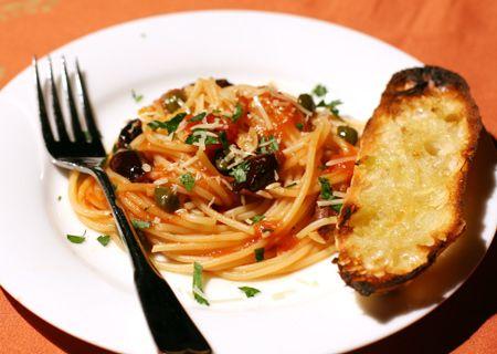 Spaghetti alla Puttanesca. I can make this low Cal low fat. Yum.