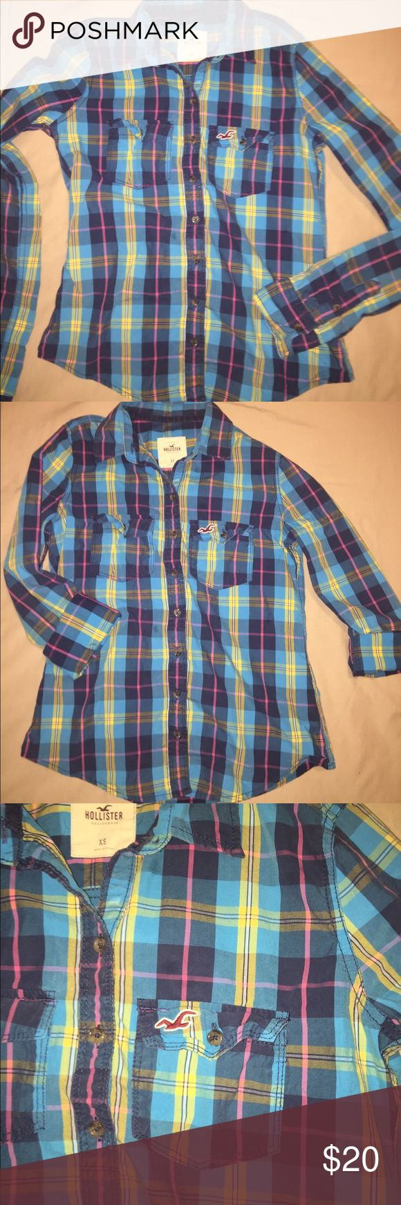 Women's Hollister Plaid Top Size Small Beautiful women's Hollister button down. Cute plaid design in bright vibrant colors. Size small in excellent condition. Wear with the sleeves down in the winter or roll them up for a cute spring look. Comes from a pet free smoke free home. Hollister Tops Button Down Shirts