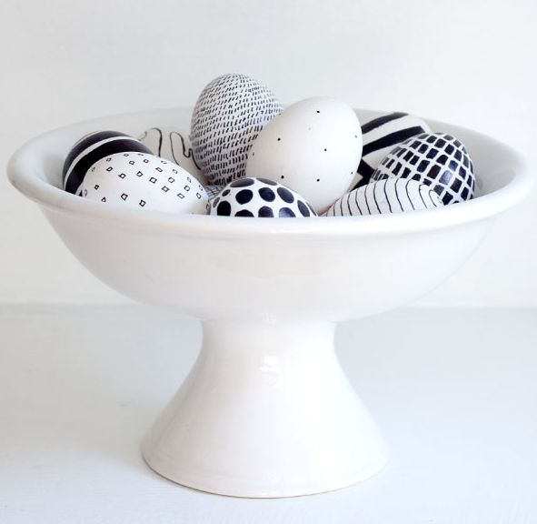 Love this idea: Use a black Sharpie for older kids (or you) to decorate modern Easter Eggs as a great centerpiece.