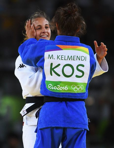 Odette Giuffrida Photos - Majlinda Kelmendi of Kosovo (blue) is congratulated as she wins gold by silver medalist Odette Giuffrida of Italy afterthe Women's -52kg gold medal final on Day 2 of the Rio 2016 Olympic Games at Carioca Arena 2 on August 7, 2016 in Rio de Janeiro, Brazil. - Judo - Olympics: Day 2