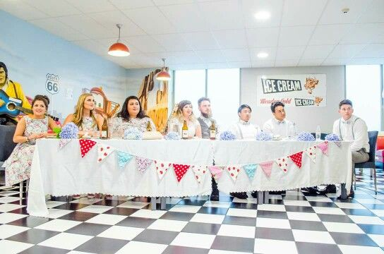 Vintage Wedding photo by letfus.com. 50s diner bridal party table. Bunting