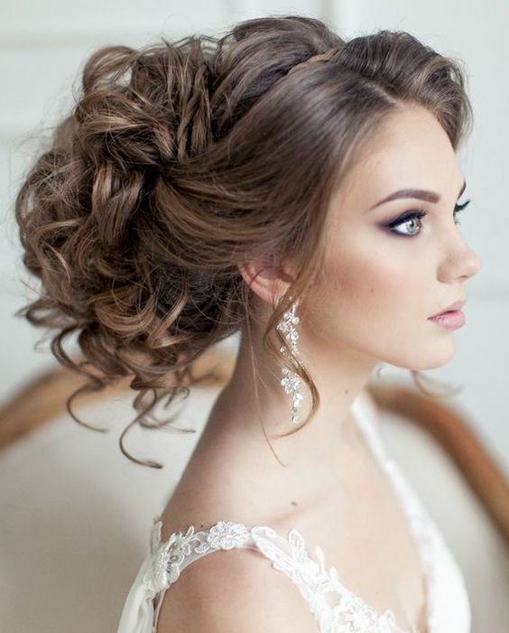 Trendy messy updo wedding hairstyle for an effortless look; Featured Hairstyle: Elstile