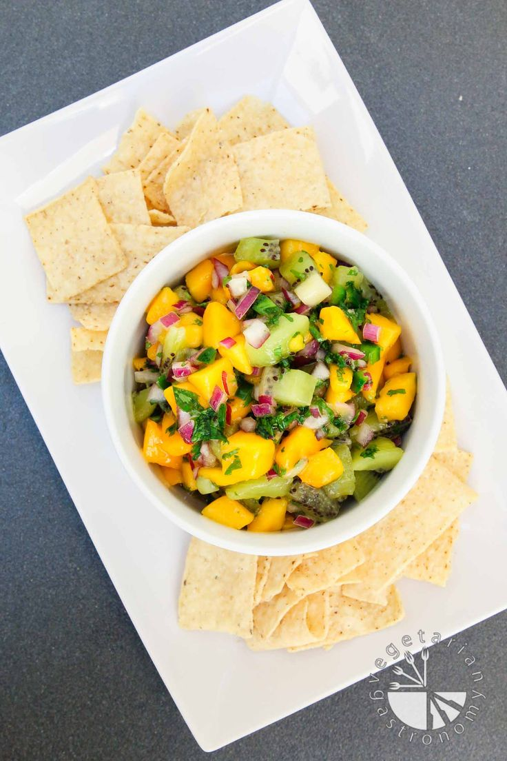 Quick and easy 5 ingredient Fresh Mango Kiwi Salsa recipe made in only 10 minutes! Raw ingredients, fresh flavors, sweet & salty, with a little heat. | www.vegetariangastronomy.com | #vegan #glutenfree