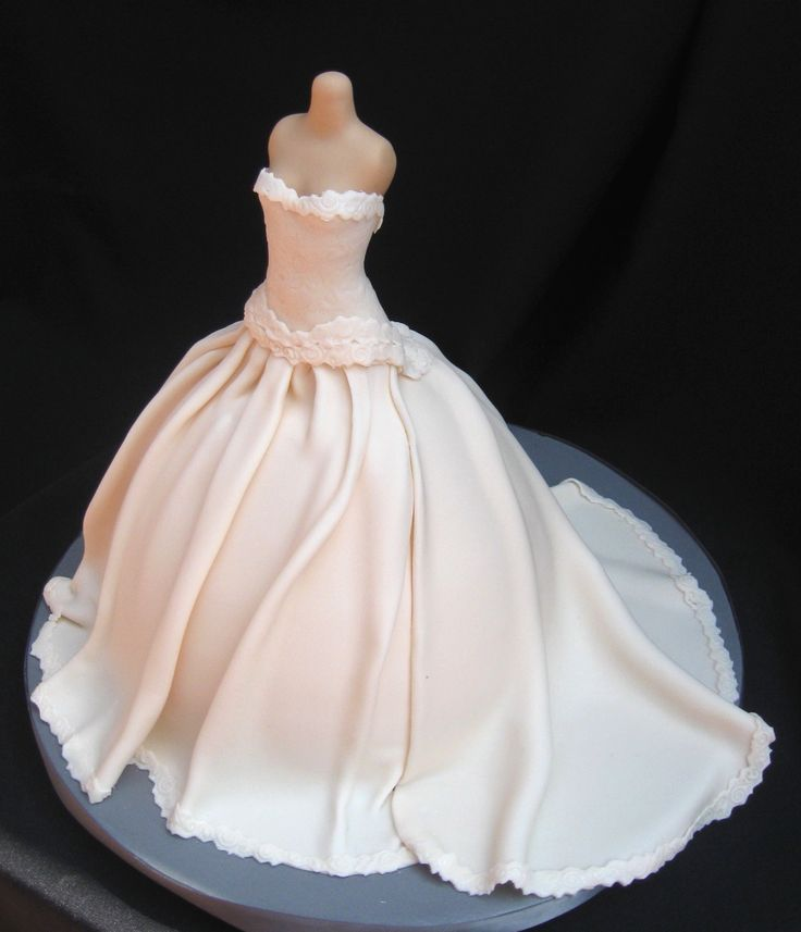 Wedding dress cake. For a fall wedding, I'd add some leaves, pearls & rhinestones along the base. Some candy clear rhinestones at the top of the dress to add sparkle. Not too much though, very little.