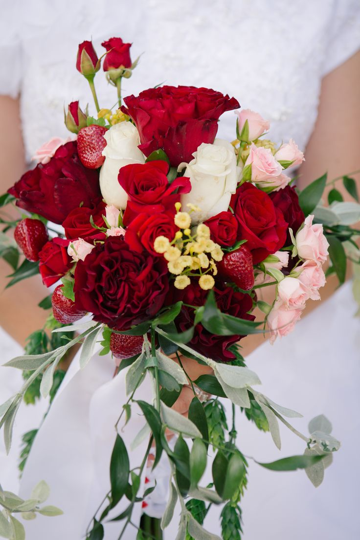 Close up of the small bouquet...you can see the strawberries! #strawberrywedding