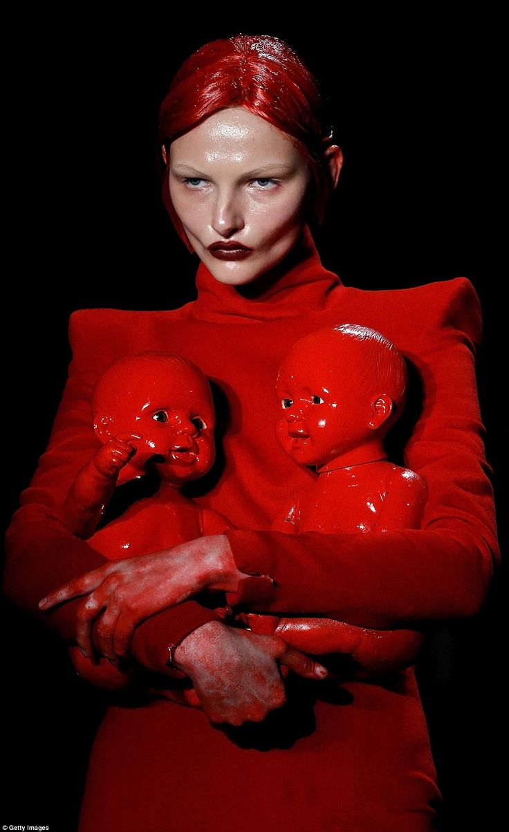 The show was full of unsettling touches such as a model holding two dolls that looked as if they were covered in blood