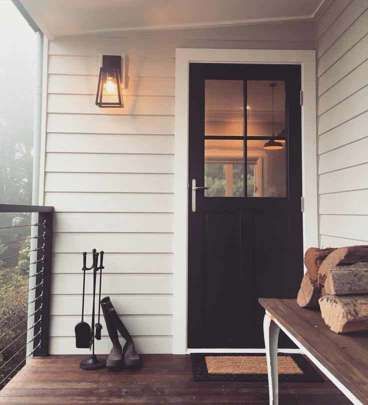 Our newly renovated side porch. Completed just in time for winter. Our gorgeous timber door is painted in Dulux Domino. Weatherboards are Dulux White Duck.