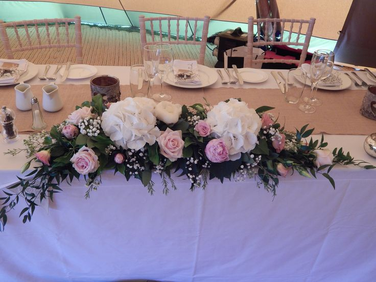 One of the top table arrangements using white hydrangeas, Sweet Avalanche roses and peonies.