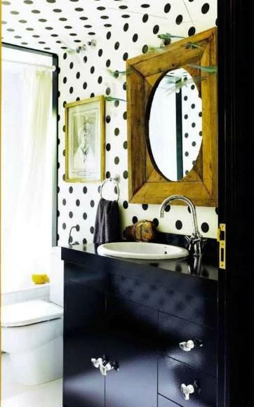 Amazing execution. Polka dots that manage to look sophisticated--neither childish or like a dalmation.  The gold mirror really breaks it up. Bathroom covered in polka dots; via AD Espana