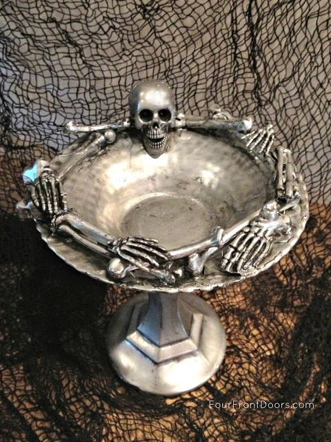 Skeleton Dish. Take apart a Dollar Store skeleton & glue (E6000) to glass plate. Spray w/silver paint. Dry. Paint over w/black acrylic paint in small area at a time. Wipe off w/rag.
