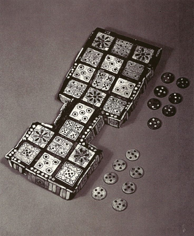 A Sumerian board game and playing pieces made of shell, bone, lapis lazuli, and red limestone. They were found in the Royal Cemetery at Ur and dates back to the twenty-fifth century B.C.E. The game board measures about 10.5 inches long and 4.5 inches wide.