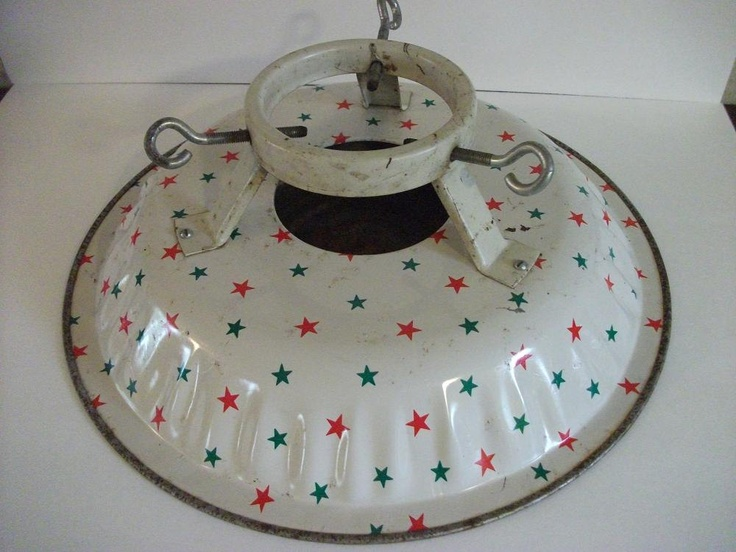 Vintage Christmas Tree Stand. 20.00, via Etsy. Covered in Red and Green stars. So sweet!