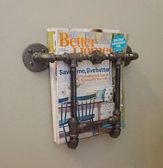 Industrial Pipe Magazine Rack A decorative way to display and store magazines, can be mounted on any area that is easily accessible. With