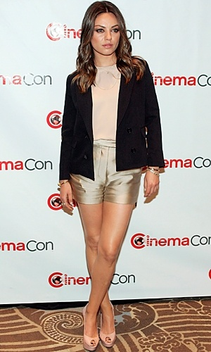Mila Kunis in Phillip Lim. Those gold shorts look great against her tanned legs!