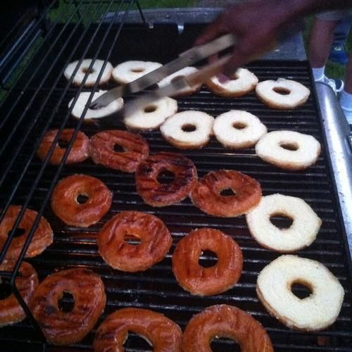 I observed this dessert hack at a relative's house recently: basic glazed Dunkin' Donuts sliced crosswise, charred briefly on the grill, and turned into ice cream sandwiches.