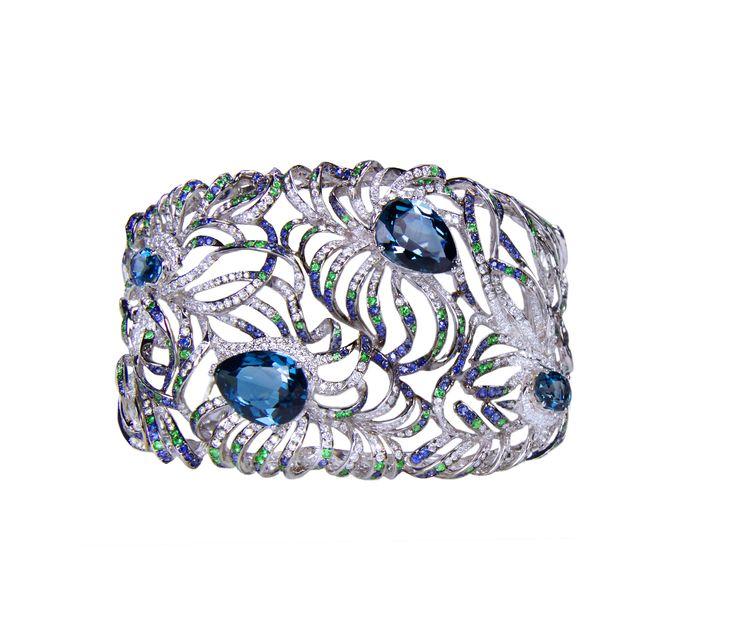 Divine Bracelet - 90 grams of 19 karat gold, set with 26 karats of Diamonds, Blue Sapphires, Tsavorites and Blue Topaz, pure luxury, high fashion, high design