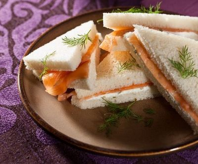 Smoked Salmon Tea Sandwiches  These smoked salmon sandwiches model the classic combination of cream cheese and smoked salmon. Accessorized with capers, lemon and black pepper, expect little flavor sensations on your tongue.