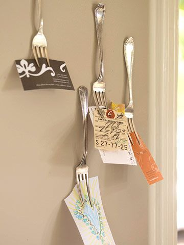 Functional Forks from BHG | Mismatched forks -- hung with self-adhesive hook-and-loop fastener dots -- create an interesting wall display for the office, holding important business cards, receipts, and other notes