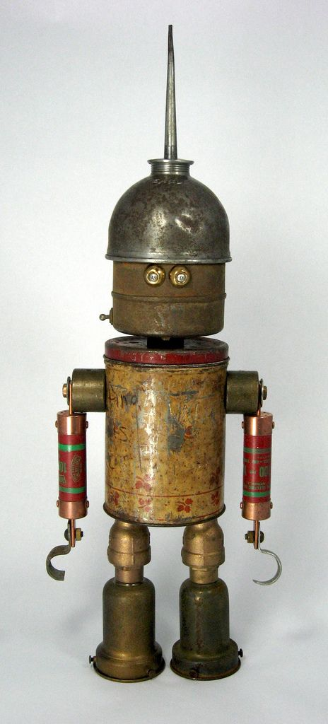 https://flic.kr/p/5NS6cc | Fuser - Robot Assemblage Sculpture | Robot sculpture assembled from found objects by Brian Marshall - Wilmington, DE. Items included in my sculptures vary from vintage household kitchen items to recycled industrial scrap. Some of my favorite items to use are old oil cans, aluminum measuring spoons, electrical meters, retro blenders, anodized cups, and pencil sharpeners.