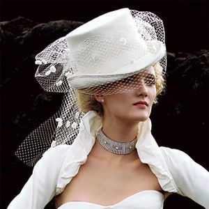 the only thing i'd change is the veil: finer mesh with maybe tiny pearl beads around the fringe.