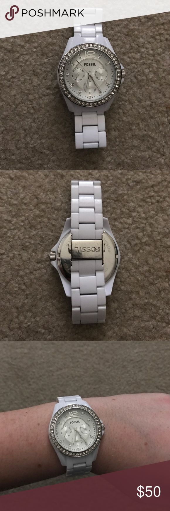 White fossil watch Good condition just a few scratches on the back clasp. No stones missing. The battery is dead but can be replaced for fairly cheap. Fossil Accessories Watches