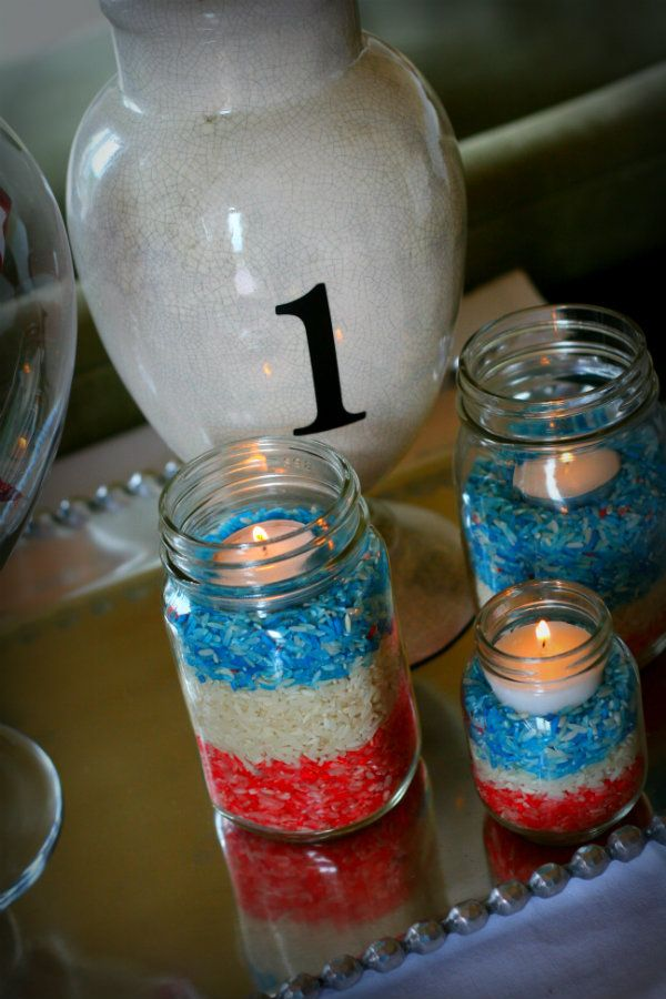Check out these awesome 4th of July candles (or Memorial Day etc....)  LOVE this idea and how fun to have the kids help with it!  Great gift ideas too....just sayin...you could make them to match ur decor....