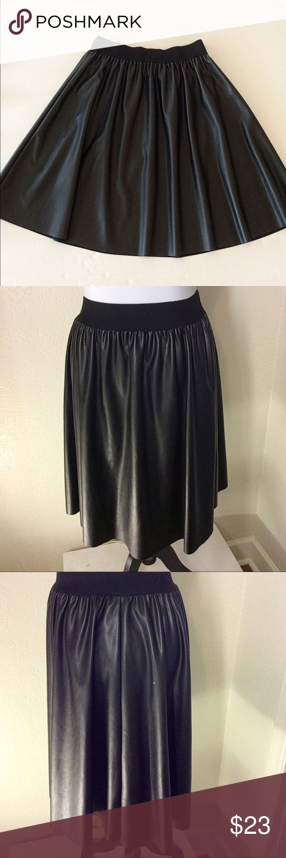"""CALVIN KLIEN FAUX LEATHER A-LINE PLEATED SKIRT Faux leather skirt with elastic waist. There are spots on the back left and on the back right near the side seam, possibly bleach spots (see pictures 7 and 8). Measures flat 15"""" across elastic waistband and 23"""" waist to hem. Calvin Klein Skirts"""