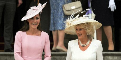 The Duchess of Cambridge (left) in her Kiwi-designed (Emilia Wickstead), rose coloured dress, pictured with the Duchess of Cornwall.  Nice hats too btw!